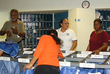 Airport Post Office staff members work to dispatch air mail to meet the new 9 a.m. deadline.