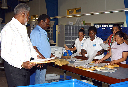 Staff at the Airport Post Office and Mail Processing Centre sorts the recently discovered letters and packages so that they can reach their intended destinations without further delay.