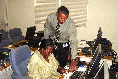 Cable and Wireless' Kennedy McGowan worked with postal worker Marina Dawkins during one of the training session.